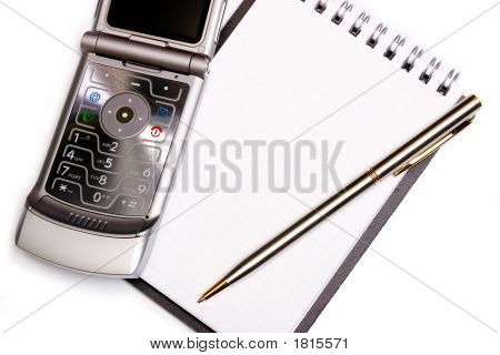 Office Equipment Concept - Spiral Notebook, Pen And Modern Phone On It