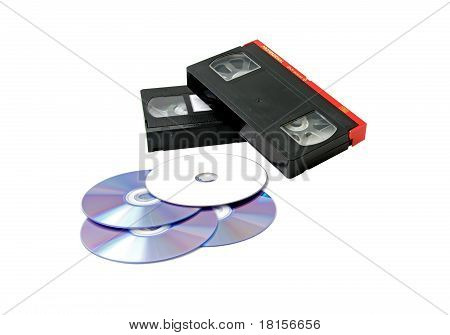 VHS Tapes And Cd Drives On A White Background.