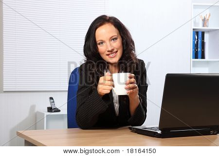 Coffee Break For Beautiful Woman At Office Desk