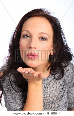 Beautiful Young Woman Blows Kiss From Her Hand