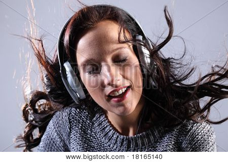 Beautiful Woman Listening To Music On Headphones