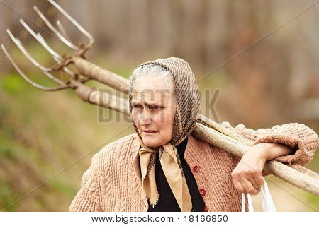 Senior Farmer Woman With A Fork