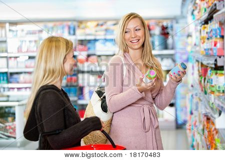 Young women shopping together in the supermarket