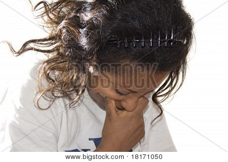 Young Woman Looking Down With Disbelief