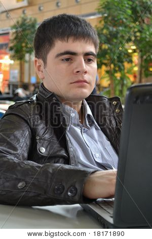 Casual Young Man With His Laptop