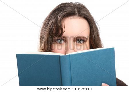 Green Eyes Of Woman Looks Up From Reading A Book