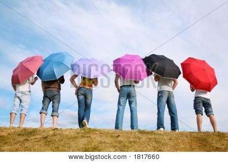 The Group Of People With The Umbrellas