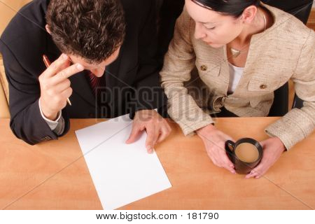 Man And Woman Reading Contract