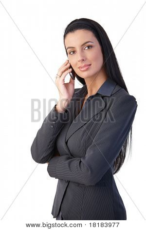 Confident smart businesswoman on mobile phone call, smiling at camera.?