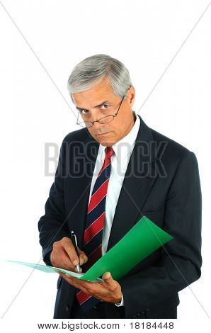 Portrait of a serious middle aged business man writing in a file folder. Vertical format isolated on white.
