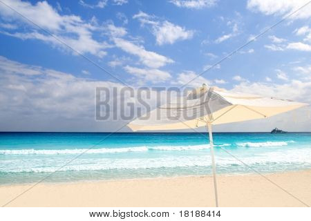 Parasol white sunroof in caribbean beach turquoise sea