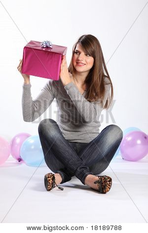 Beautiful Young Girl Curious About Birthday Gift
