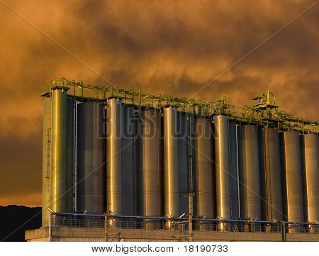 Refinery against red sky