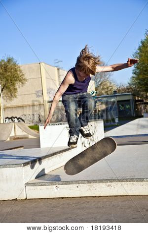 Boy With Scateboard Is Going Airborne