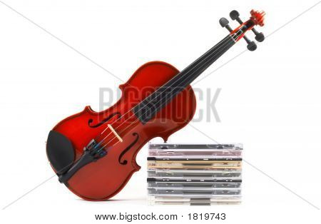 Violin Leaning On Stack Of Cds
