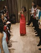 Multi-ethnic teenagers dancing at prom poster