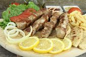 stock photo of souvlaki  - Plate of traditional Greek pork skewer  - JPG