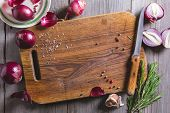 Red Onion Bulb On Brown Cutting Board. poster