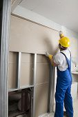 Worker Installing Drywalls poster