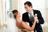image of waltzing  - Bride and groom dancing the first dance at their wedding day - JPG