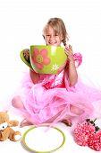 foto of barbie  - Cute little girl having a tea party - JPG