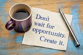 Do not wait for opportunity, create it - handwriting on a napkin with a cup of espresso coffee poster