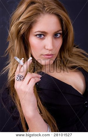 an young beautiful woman close up portrait smoking