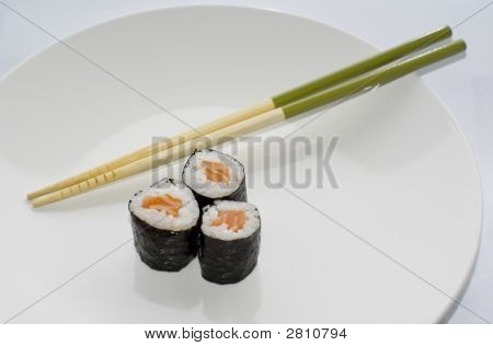 Three Sake Maki Salmon Rolls Sushi With Chopsticks