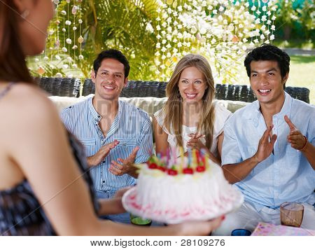 Friends With Cake At Birthday Party