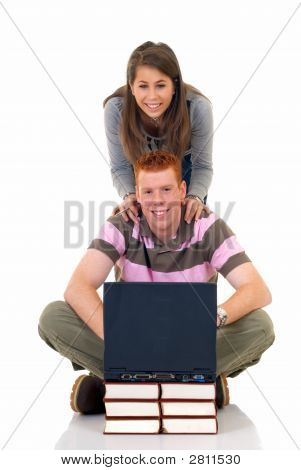 Teen Students Working On Laptop