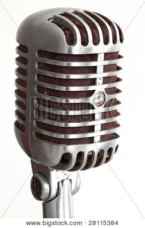 extreme closeup of vintage microphone isolated on white