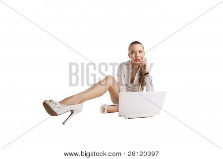 sexy woman sit with notebook and long legs