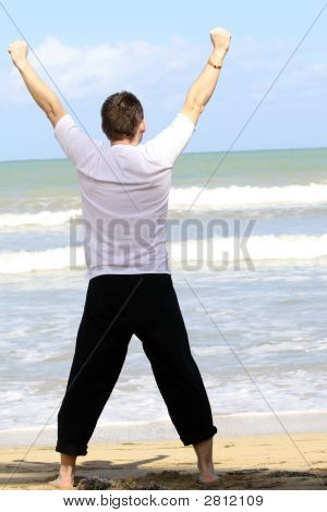 Man Doing Sport On The Beach