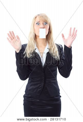 surprised woman holding a white card covering her mouth