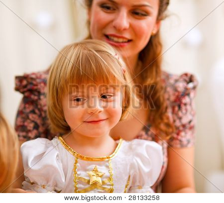 Portrait Of Mother And Daughter Looking On Something