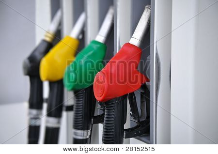 Gasoline pump nozzles at petrol station