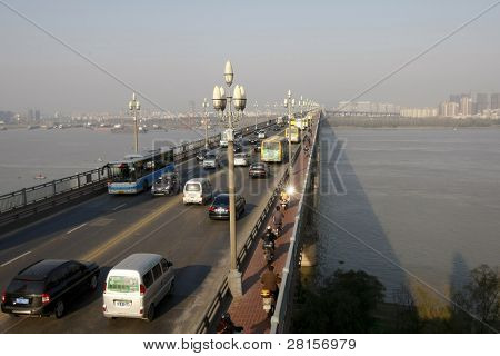 NANJING, CHINA- NOVEMBER 24. Vehicles cross the Nanjing Yangtze River Bridge on November 24, 2011 in Nanjing, China. The 6.7km bridge was completed in 1968 and officially opened by Chairman Mao Zedong
