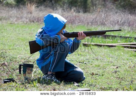 Boy Shooting Gun