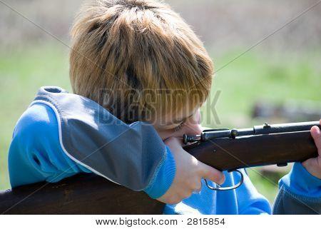 Boy Pulling Trigger