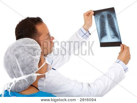 Doctors Checking An X-Ray