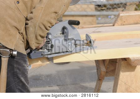 Carpenter Cutting Steps With Saw