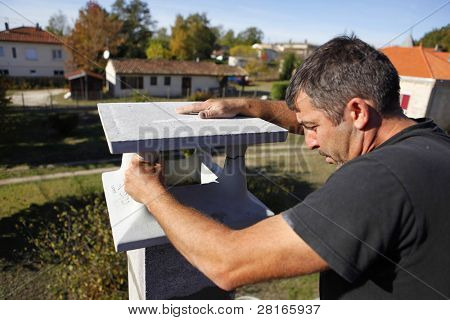 Builder finishing a gatepost