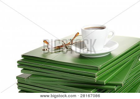 Many green folder with cup of coffee isolated on white