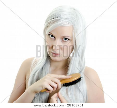 Portrait Of Young Girl Brushing Hair Isolated On White