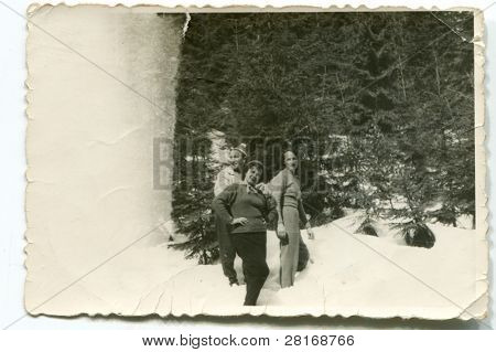 Vintage photo of two women and a man in winter (forties)