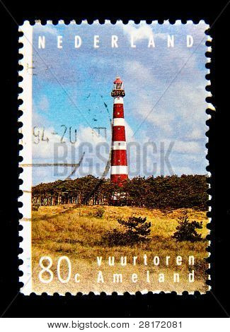 HOLLAND - CIRCA 1995: A stamp printed in Holland shows lighthouse at the island Ameland, circa 1995