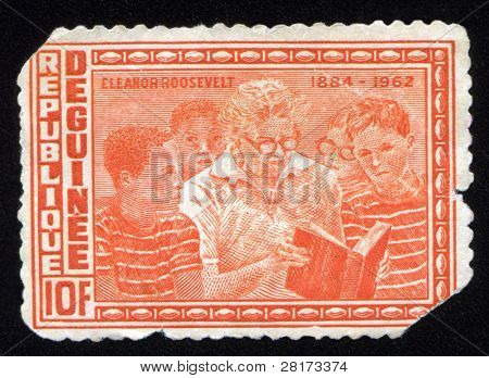 Old jagged dirty vintage antique postage stamp with Eleanor Roosevelt