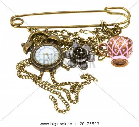 Vintage brooch with warch, flower and cup  isolated on white background