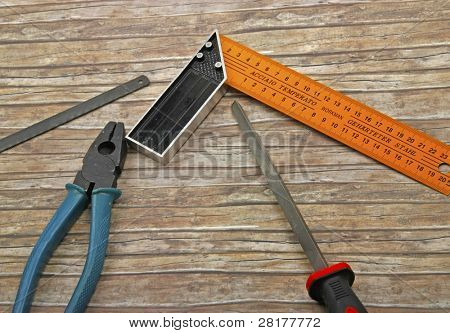 Technician's tools on old wood background