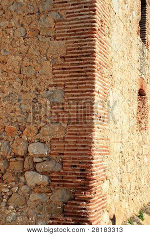 bricks corner detail in masonry wall from ancient monastery architecture in spain